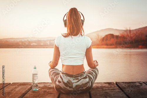 Yoga athletic sporty woman relaxing outdoors