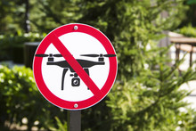 The Sign Prohibiting The Flight Of Drones Against The Background Of Green Vegetation