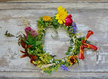 Flower Wreath Isolated On Wooden Board.