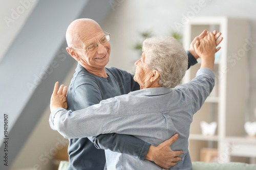 fototapeta na drzwi i meble Cute elderly couple dancing at home