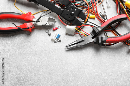 Different electrical tools on grey background Wallpaper Mural