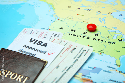 Passport, tickets and approved visa on map Tablou Canvas