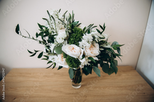 Lush bouquet of white roses and greenery which stands in a gl ... on flower basket stand, flower pedestal stand, flower bucket stand, flower garden stand, flower shop stand, teapot stand, flower table stand, flower crystal stand, fireplace stand, flower bowl stand, planter stand, clock stand, flower bouquet stand, flower lamp stand, flower pot stand, flower display stands, flower box stand, flower column stand, flower tree stand, flower plant stand,