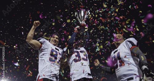 american football team celebrating victory