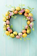 Easter Eggs Wreath On Light Bl...
