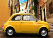 Retro car on background of Colosseum in Rome Italy
