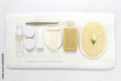 Towel and bathroom amenities kit isolated on white background. Canvas Print