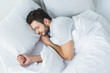 canvas print picture - top view of bearded man sleeping on bed in bedroom