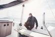 Aged man on sailboat