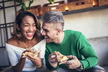 Mixed Race Couple Eating Pizza...