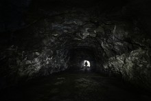 Man In A Dark Cave Watch Out Of The Exit - Depression Concept
