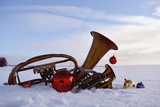 brass musical wind instrument on snow and Christmas baubles