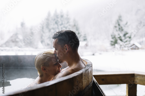 Fotografie, Obraz  Young couple in hot spring