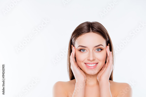 Obraz Freshness purity youth model concept. Close up photo of beautiful with sensual flawless smooth soft no wrinkles skin woman touching temples cheeks with palms isolated on white background copy-space - fototapety do salonu