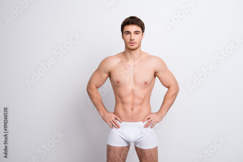 Chest clean clear people person concept. Portrait of handsome muscular virile masculine with abs six-pack sportsman holding hands on waist-line clothed in white underpants isolated on white background