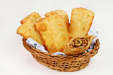 Brazilian typical pastry called pastel in white background with one of meat open - 194281558