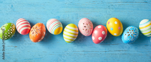 Row of colorfully painted Easter eggs Wallpaper Mural