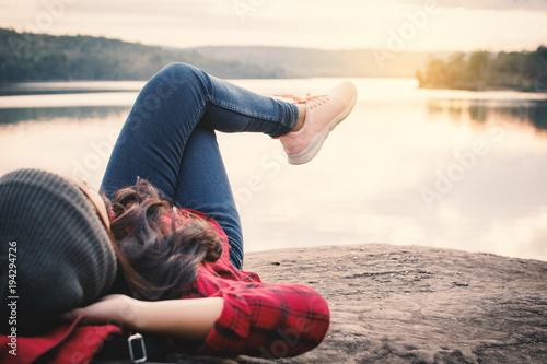 Fotomural Relaxing moment Asian tourist sleeping on rock waiting for sunset ,enjoying time