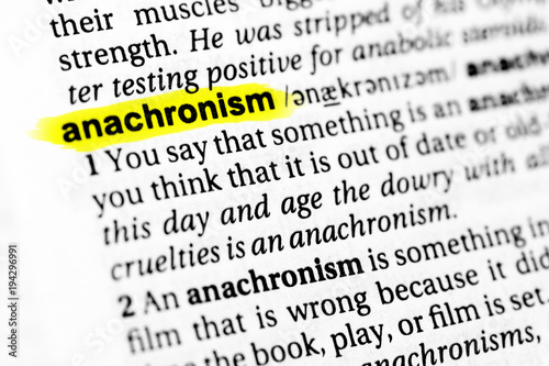 Photo Highlighted English word anachronism and its definition in the dictionary