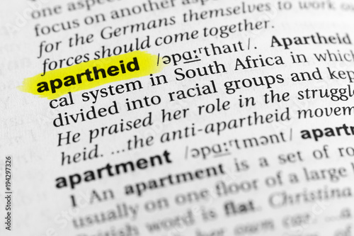 Photo Highlighted English word apartheid and its definition in the dictionary