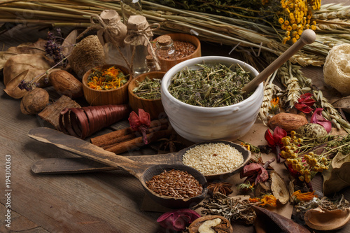 Photo  Bunch of healing herbs on wooden board