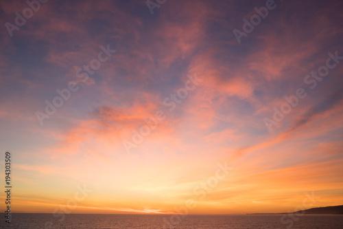 Obraz Sunset evening sky over sea - fototapety do salonu