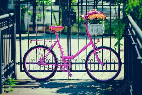 Deurstickers Fiets pink bike standing by metal barrier