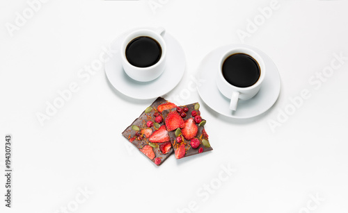 Spoed Foto op Canvas Chocolade Two cups of coffee and hand-made chocolate with dried strawberries and berries on a white background