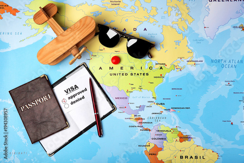 Passports, sunglasses and toy airplane on map Fototapet