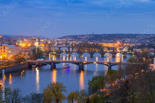 Fototapeta Old town and bridges over Vltava river illuminated night view from Letenske garden. Prague, Czech Republic obraz na płótnie