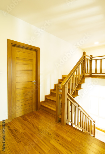 Tuinposter Trappen House interior with modern wooden staircase