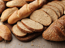 Fresh Bread With Spikelets Of Wheat On A Wooden Background