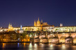 Amazing night view of Hradcany (Prague Castle) with St. Vitus Cathedral and Charles bridge at night, Bohemia landmark. Prague, Czech Republic.