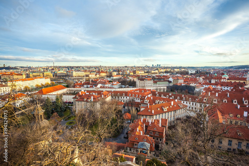 View of Prague over houses with red roofs Poster