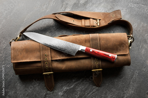 Excellent Japanese chef's knife from Damascus steel. Fototapeta