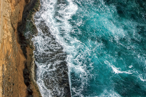 aerial view of ocean waves on cliff