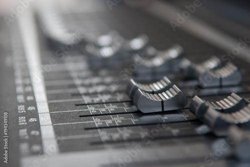 Fotografija Close up professional studio mixing console fader in grey