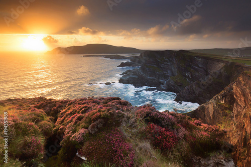 Europe, Ireland, Portmagee cliffs at sunset along the Ring of Kerry