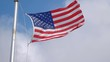 Professional video of United States flag waving in the wind in 4K slow motion 60fps