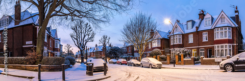 Winter sunrise in snowy suburb in London