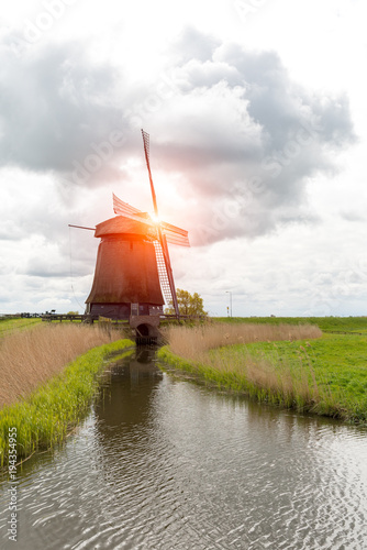 Tuinposter Molens Sunset above windmill