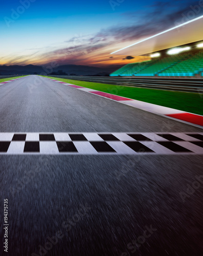 Poster F1 Motion blurred racetrack with start or end line . Night scene . Vertical or poster format .