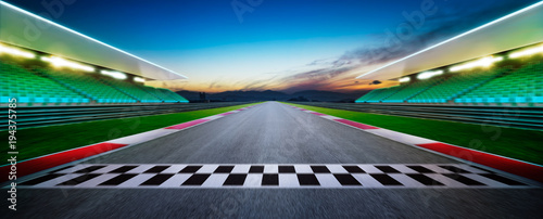 Keuken foto achterwand F1 Motion blurred racetrack with start or end line . Horizontal format .Night scene .