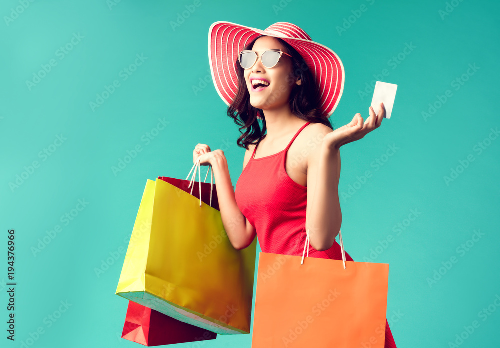 Fototapety, obrazy: Women are shopping In the summer she is using a credit card and enjoys shopping.
