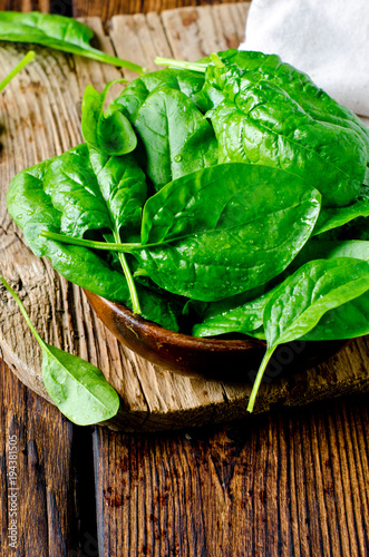 Fresh spinach on a cutting wooden board