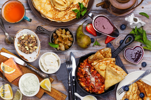 Fototapeta Colorful, tasty and savory breakfast with crepes and different fillings and sauces obraz