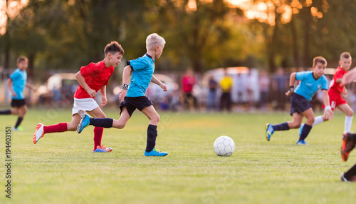 Young children players football match on soccer field