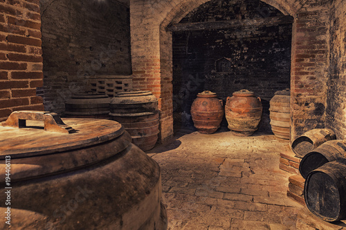 Old barrels of wine in the ancient cellar, Italy Canvas Print