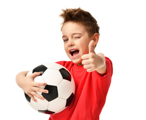 Fan sport boy player hold soccer ball in red t-shirt celebrating happy smiling laughing show thumbs up success sign