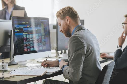 Fotografía  Stock Broker Working at Office